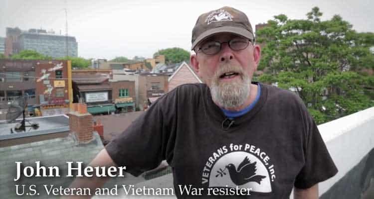 Veteran John Heuer speaks in support of U.S. war resisters in Canada