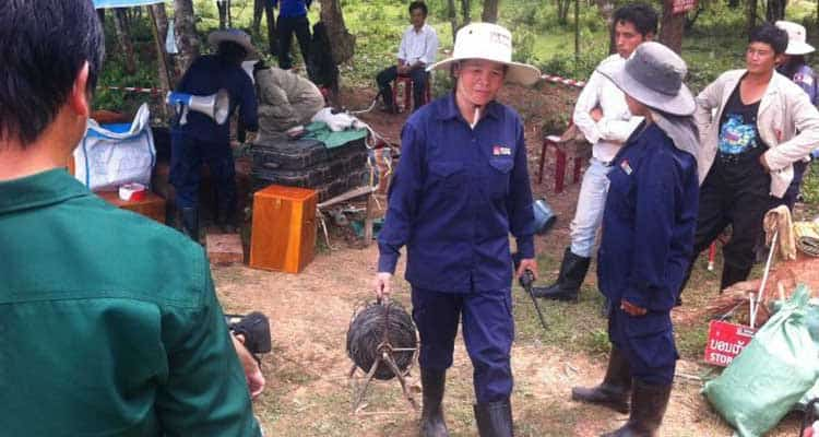 Lao women leading effort to clear millions of unexploded bombs left over from Vietnam War
