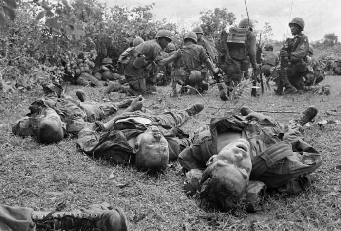 Bodies of US paratroopers lie near a command post during the battle of An Ninh, 18 September 1965. The paratroopers, of the 1st Brigade, 101st Airborne Division, were hit by heavy fire from guerrillas that began as soon as the first elements of the unit landed. The dead and wounded were later evacuated to An Khe, where the 101st was based. The battle was one of the first of the war between major units of US forces and the Vietcong Photograph: Henri Huet/AP
