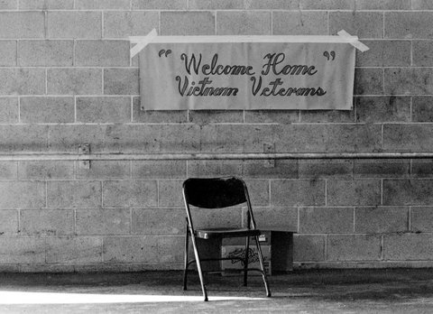 empty chair under welcome home banner