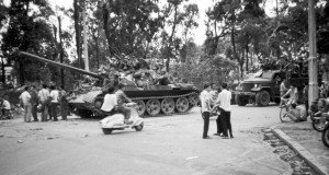 A tank rolls into Saigon on April 30, 1975, while curious people chat with the newly arrived soldiers. Claudia Krich/Courtesy photo