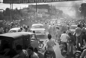 A truck carrying North Vietnamese soldiers, foreground left, is stuck in a huge traffic jam on May 1, 1975, as everyone was out on the streets following the American pullout. Claudia Krich/Courtesy photo