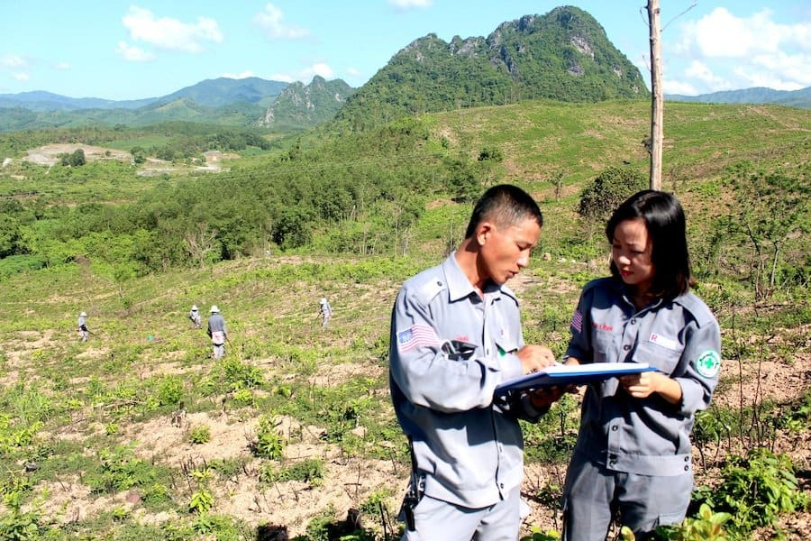 Young woman, big responsibility: She manages 160 deminers and support staff who clean up cluster bombs and other explosives in Quang Tri Province