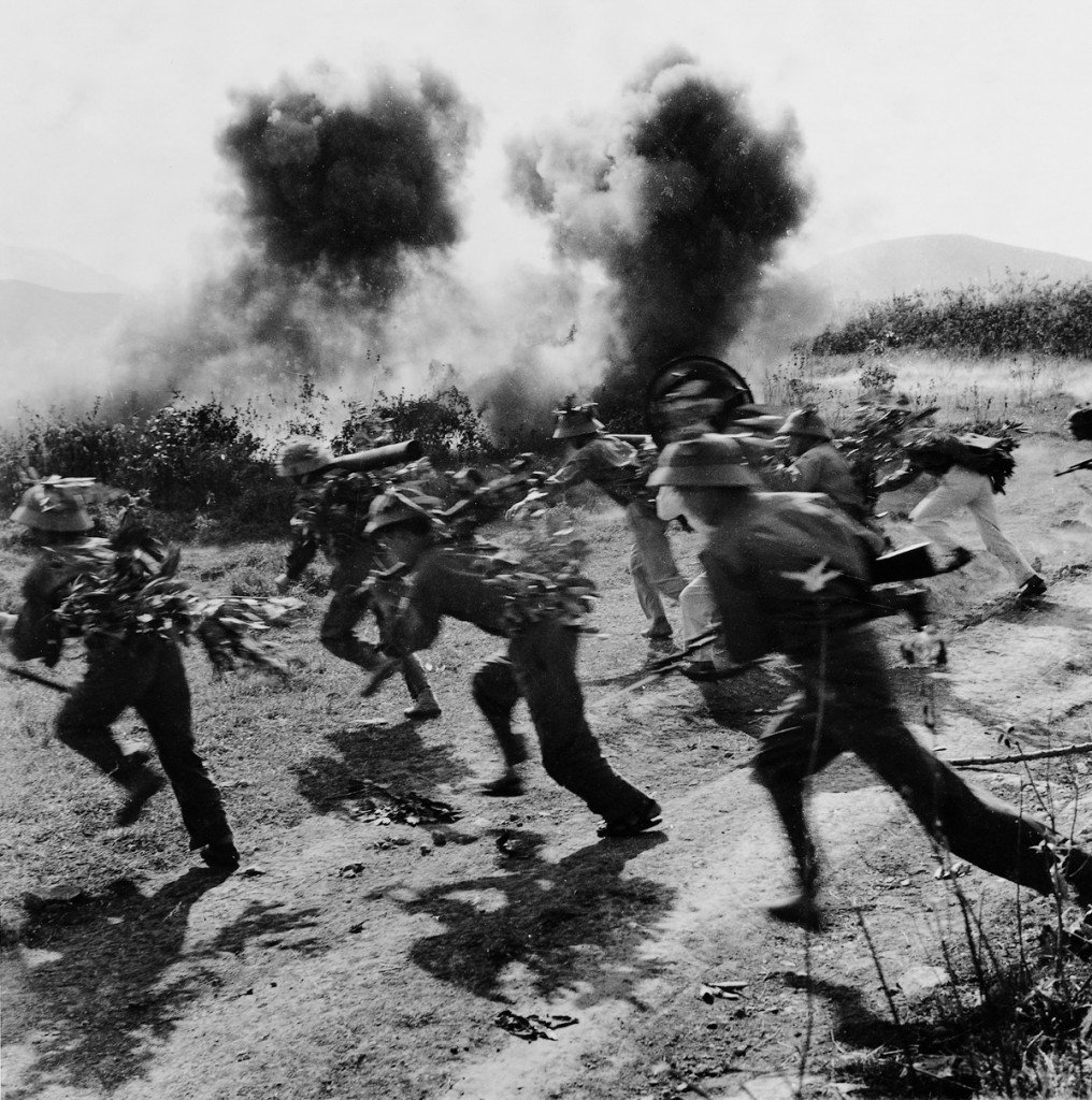 1972 NVA soldiers dash across open ground near strategic Highway 9 in southern Laos during Operation Lam Son 719, the South's failed attempt to cut the Ho Chi Minh Trail. IMAGE: NGUYEN DINH UU/ANOTHER VIETNAM/NATIONAL GEOGRAPHIC BOOKS
