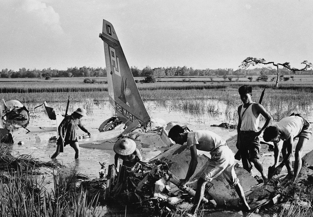 une 1972 Militia members sort through the debris of an American plane downed by small-arms fire in the Hanoi suburbs. The pilot had been flying at treetop level to avoid radar detection, but such low-flying planes were more vulnerable to small arms. U.S. planes targeted Hanoi industrial sites, but most industries were relocated to the countryside. IMAGE: DOAN CONG TINH/ANOTHER VIETNAM/NATIONAL GEOGRAPHIC BOOKS