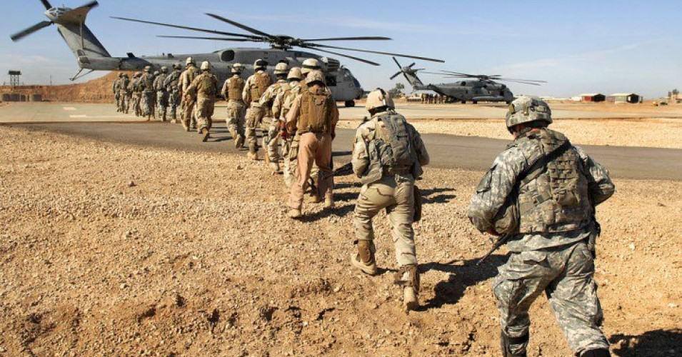 troops in line to board helicopter
